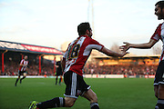 Ricketts goal celebration during the Sky Bet Championship match between Brentford and Wolverhampton Wanderers at Griffin Park, London, England on 29 November 2014.