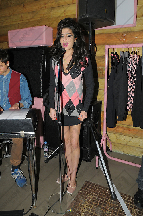 21.OCTOBER.2010. LONDON<br /> <br /> AMY WINEHOUSE PERFORMS A LOW KEY GIG AT THE FRED PERRY STORE AT SPITALFIELDS MARKET TO LAUNCH HER NEW FRED PERRY CLOTHING RANGE NAMED AW10.<br /> <br /> BYLINE: OPTICPHOTOS.COM<br /> <br /> *THIS IMAGE IS STRICTLY FOR UK NEWSPAPERS AND MAGAZINES ONLY*<br /> *FOR WORLD WIDE SALES AND WEB USE PLEASE CONTACT OPTICPHOTOS - 0208 954 5968*