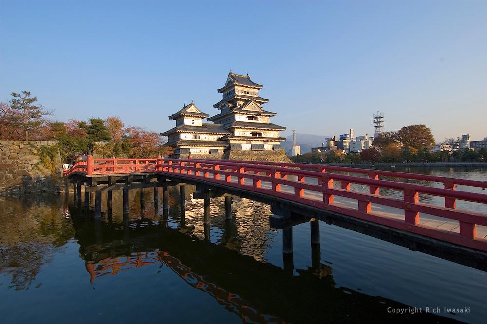 Uzumi-bashi (bridge) over castle moat leads to Matsumoto castle at sunset, Matsumoto, Nagano Prefecture, Japan