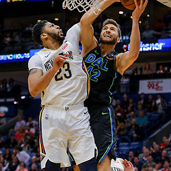 Mar 20, 2018; New Orleans, LA, USA; Dallas Mavericks forward Maximilian Kleber (42) shoots as New Orleans Pelicans forward Anthony Davis (23) defends during the second quarter at the Smoothie King Center. Mandatory Credit: Derick E. Hingle-USA TODAY Sports