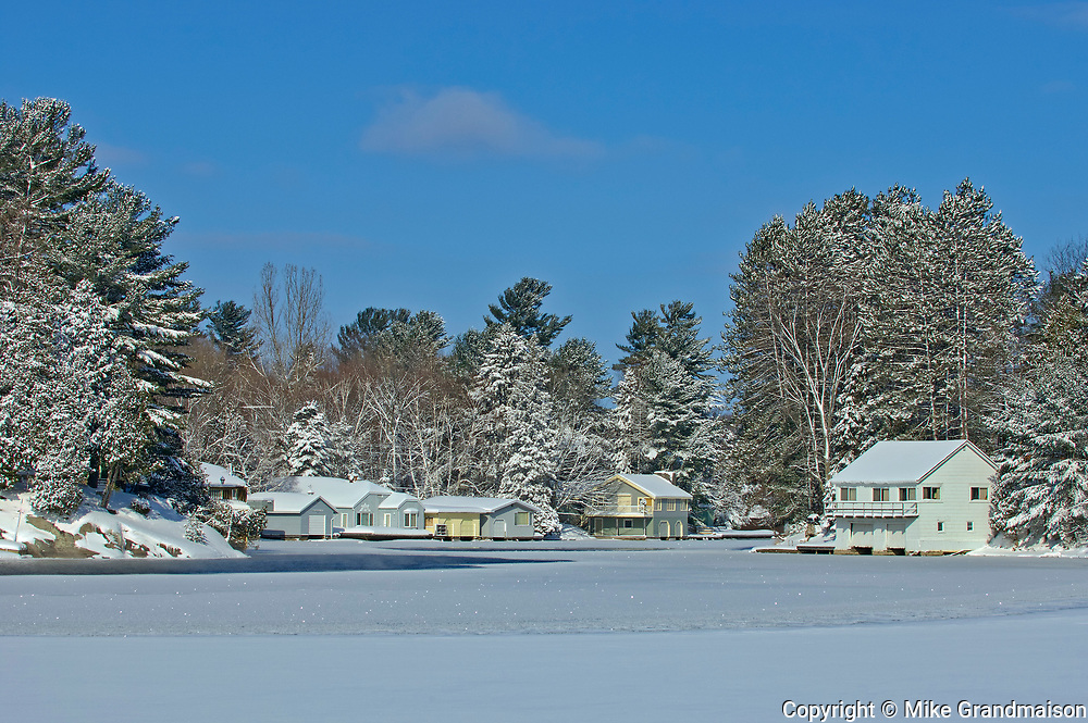 Cottages on Mary Lake in winter<br />Port Sydney<br />Ontario<br />Canada
