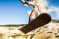 Young man sandboarding on the dunes of Ribanceira Beach. Imbituba, Santa Catarina, Brazil. / <br /> Homem jovem andando de sandboard nas dunas da Praia da Ribanceira. Imbituba, Santa Catarina, Brasil.