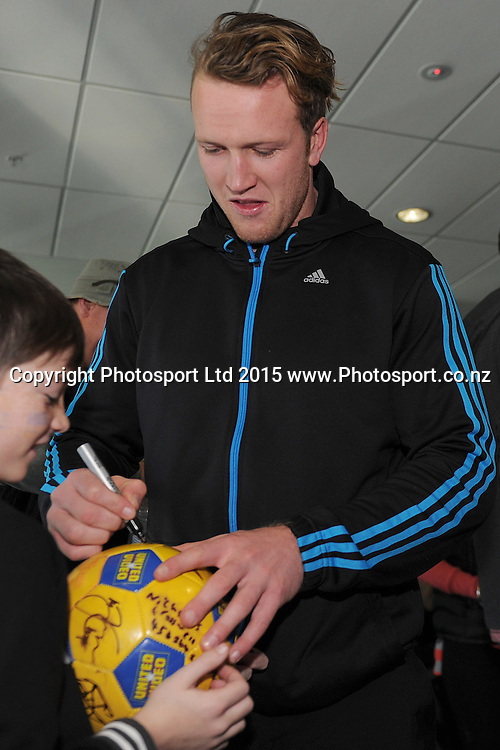 Gareth Evans of the Highlanders signs autographs, during the Highlanders Airport Arrival after winning the Super Rugby Title, Dunedin Airport, Dunedin, New Zealand, 5 July 2015. Credit: Joe Allison / www.Photosport.co.nz