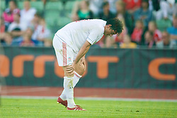 OSLO, NORWAY - Wednesday, August 5, 2009: Liverpool's Albert Riera limps out of the game injured against FC Lyn Oslo during a preseason match at the Bislett Stadion. (Pic by David Rawcliffe/Propaganda)