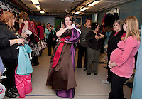Emma Dussault awaits her turn for the dressing room during the Faith, Hope and Love Foundation's 5th annual Gowns for Girls event held Saturday afternoon at Franklin Community Center.  (Karen Bobotas/for the Laconia Daily Sun)
