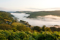 © Licensed to London News Pictures. 13/08/2019. Erwood, Powys, UK. Early morning fog is seen in the Wye Valley near Erwood in Powys Wales after temperatures dropped to around 6 deg C during the night. Photo credit: Graham M. Lawrence/LNP