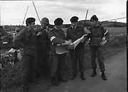"""Army Exercises In Co Sligo.   (L37).<br /> 1977.<br /> 05.09.1977.<br /> 09.05.1977.<br /> 5th September 1977.<br /> The Army Reserve Brigade, which is made up of regular units from the Southern Command, are conducting a series of conventional military exercises in counties Mayo and Sligo from the 5th to the 9th September. Approximately 1,500 men and 250 vehicles are involved. The exercise was codenamed """"Humbert"""" after an ill fated expedition by French troops into Ireland on 23rd August 1798. 1,100 French troops with Irish support took on the incumbent English forces. After some initial success they were defeated at Ballinamuk on 8th Sept 1798 by the army of Cornwallis.<br /> <br /> Pictured at the military exercises were (L-R) Corp Tim Flaherty, Pte J Murphy,Capt Martin Coughlan, Comdt E O'Hanlon and Capt Brendan Forde."""
