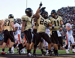 Wake Forest running back Brandon Pendergrass (22) celebrates with Riley Skinner (11) and D.J. Boldin (4) after scoring a touchdown against Virginia.  The Wake Forest Demon Deacons defeated the Virginia Cavaliers 24-17 in NCAA Division 1 Football at BB&T Field on the campus of Wake Forest University in Winston-Salem, North Carolina on November 8, 2008.