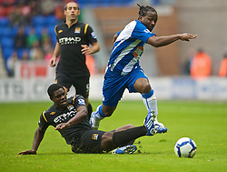 WIGAN, ENGLAND - Sunday, October 18, 2009: Manchester City's Micah Richards and Wigan Athletic's Jason Scotland during the Premiership match at the JJB Stadium. (Pic by David Rawcliffe/Propaganda)