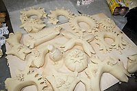 bread sculptures on a counter before ovening.