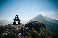 Munnar, India -- February 16, 2018: A small shrine built atop a mountain peak.