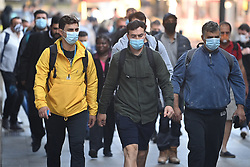 © Licensed to London News Pictures. 15/06/2020. London, UK. Commuters at Victoria Station in London, on the day the the easing of lockdown rules means all passengers must wear face masks. Government has introduced further measures to allow non-essential shops and services to reopen under social distancing conditions. Photo credit: Ben Cawthra/LNP