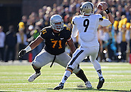 November 10 2012: Iowa Hawkeyes defensive lineman Carl Davis (71) eyes Purdue Boilermakers quarterback Robert Marve (9) as he looks to pass during the NCAA football game between the Purdue Boilermakers and the Iowa Hawkeyes at Kinnick Stadium in Iowa City, Iowa on Saturday, November 10, 2012. Purdue defeated Iowa 27-24.