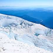 Climbers negotiate crevasses on the upper reaches of the Ingraham Glaicier during a summit of Mount Rainier on June 30, 2015. The iconic Pacific Northwest volcano is a popular challenge for mountaineers.  (Joshua Trujillo, seattlepi.com)