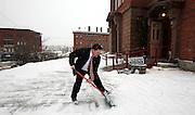Volunteer Michael Lane, of Bangor, shovels the walkway in preparation for a 2012 Republican presidential hopeful, Rep. Ron Paul, R-Texas, town hall meeting, held at the Brick Church, in Bangor, ME, Friday, Jan. 27, 2012. (Cheryl Senter for the New York Times)
