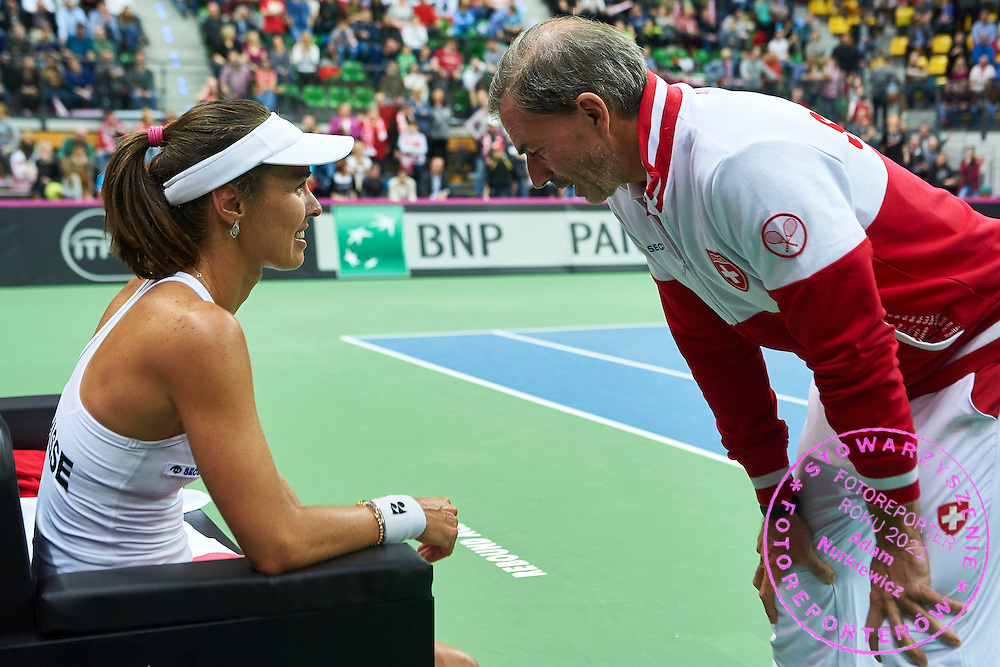 (L) Martina Hingis from Switzerland with (R) Heinz Guenthardt - captain national team after her lost game during the Fed Cup / World Group Play Off tennis match between Poland and Switzerland on April 18, 2015 in Zielona Gora, Poland<br /> Poland, Zielona Gora, April 18, 2015<br /> <br /> Picture also available in RAW (NEF) or TIFF format on special request.<br /> <br /> For editorial use only. Any commercial or promotional use requires permission.<br /> <br /> Adam Nurkiewicz declares that he has no rights to the image of people at the photographs of his authorship.<br /> <br /> Mandatory credit:<br /> Photo by &copy; Adam Nurkiewicz / Mediasport