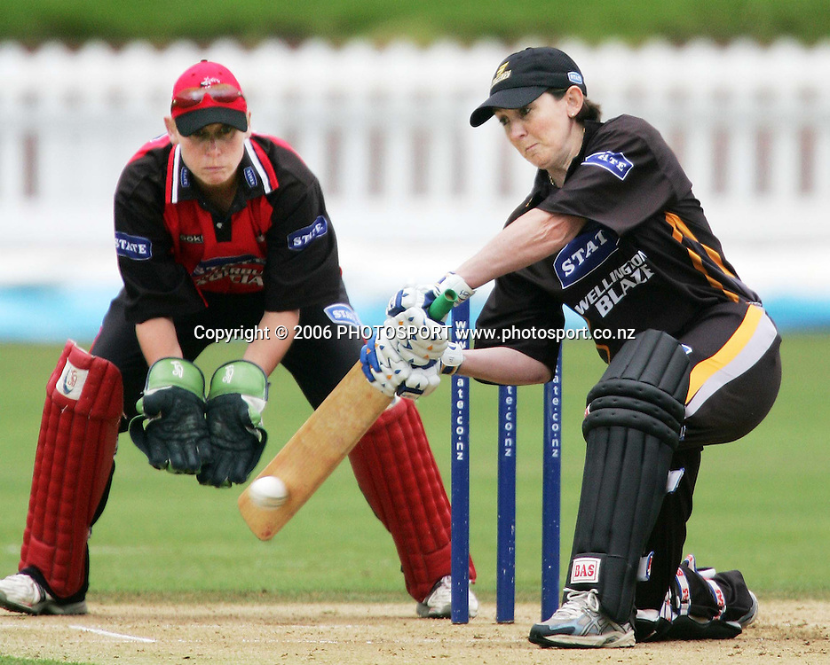 Wellington batsman Anna Smith plays a cover drive as Canterbury wicketkeeper Rowan Milburn watches on during the State League womens cricket final between the State Wellington Blaze and the State Canterbury Magicians held at the Basin Reserve in Wellington, New Zealand on Saturday, 27 January, 2007. Photo: Tim Hales/PHOTOSPORT