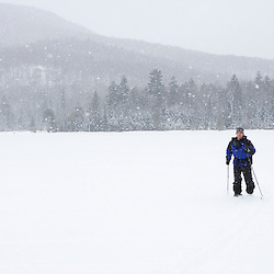 A skier makes his way across Little Lyford Pond near the AMC's Little Lyford Pond Camps in Maine's Northern Forest.