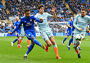 Josh Murphy (11) of Cardiff City crosses the ball as he is challenged by Marcos Alonso (3) of Chelsea during the Premier League match between Cardiff City and Chelsea at the Cardiff City Stadium, Cardiff, Wales on 31 March 2019.
