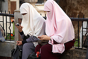 Muslim girls with cellphones at Khan-alKhalili Bazaar in Cairo, Egypt