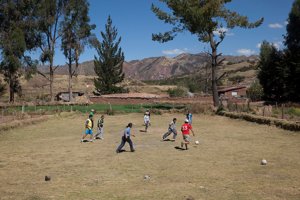 CUZCO, PERU: Local people play football by the Incan ruins of Sacsayhuaman, near Cuzco, in the Andes.