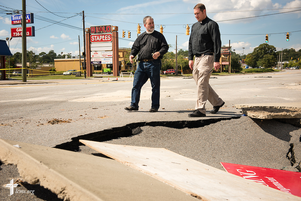 The Rev. Christopher Burger, pastor of Holy Trinity Lutheran Church in Columbia, S.C., surveys damage from recent flooding with the Rev. Michael Meyer, manager of LCMS Disaster Response, in Columbia on Thursday, Oct. 8, 2015. LCMS Communications/Erik M. Lunsford