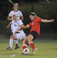 Ole Miss's Mandy McCalla (21) scores against Memphis' Kelley Gravlin (2) in soccer action at the Ole Miss Soccer Stadium in Oxford, Miss. on Sunday, September 15, 2013.