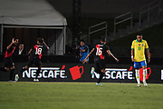 Peru defender Luis Abrahm (2) celebrates with forward Andre Carrillo (18) and midfielder Christofer Gonzales (16) after scoring a goal as Brazil defender Marquinhos (4) reacts in the second half during an international friendly soccer match, Tuesday, Sept. 10, 2019, in Los Angeles. Peru defeated Brazil 1-0.