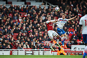 Stoke City defender Moritz Bauer (2) wins a header over Arsenal defender Nacho Monreal (18) during the Premier League match between Arsenal and Stoke City at the Emirates Stadium, London, England on 1 April 2018. Picture by Toyin Oshodi.