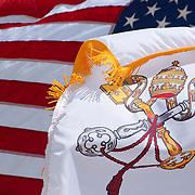 HARVEY CEDARS, NJ - JUNE 2011: An America flag and a Vatican flag fly together on the beach at the Maris Stella Retreat Center on Harvey Cedars Beach on June 25, 2011.
