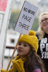 © Licensed to London News Pictures. 17/11/2013.  Demonstrators from the No More Page Three campaign march from Embankment to the South Bank via Westminster in London on 17 November 2013 to collect signatures for their petition and demonstrate against the use of topless female models in The Sun newspaper. The demonstration coincides with the 43rd anniversary of Page 3 appearing in The Sun newspaper. Photo credit : Vickie Flores/LNP.