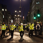 Police watching over sound system playing to a young crowd after the official march has ended in Charing Cross, blocking the road and Trafalgar Square. Numerous trade unions in the public sector called for a day of strike and in that connection marched in London against the Government's pension cuts. Most schools in Scotland were shut and more than half of all schools in England were shut for the day . Many nurses, doctors and health workers went on strike in protests against the Government's austerity measures.