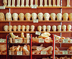 A souvenir shop in Fatima filled with candles in the shape of children, legs, feet, kidneys, hearts and livers. People will buy these according to the ailments they want the Madonna of Fatima to help them with and burn them in the flame at the Sanctuary in supplication.