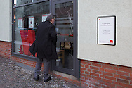 """Berlin, Germany - 19.01.2016 <br /> <br /> The SPD politician Ralf Wieland reach in the morning his office. About 4 o'clock in the morning noticed a house technician damages on the Social Democratic Party of Germany office of Ralf Wieland in Berlin-Gesundbrunnen. 5 windows were damaged by stone throws. In addition, slogans were left with Rigaer94 reference. As well as the slogan """"#tomduarsch"""" who apparently directed against the Berlin SPD politician Tom Schreiber. It is the fourth attack on the office within six months.<br /> <br /> Der SPD-Politiker Ralf Wieland erreicht am Morgen sein Buero. Gegen 4 Uhr morgens bemerkte ein Haustechniker die Schaeden am SPD-Buergerbuero von Ralf Wieland in Berlin-Gesundbrunnen. 5 Scheiben wurden durch Steinwuerfe beschaedigt. Außerdem wurden die Schriftzuege mit Rigaer94-Bezug hinterlassen. Sowie der Schriftzug """"#tomduarsch"""", der sich offenbar gegen den Berliner SPD-Politiker Tom Schreiber richtet. Es ist die vierte Attacke auf das Buero innerhalb von sechs Monaten.<br /> <br /> Photo: Bjoern Kietzmann"""