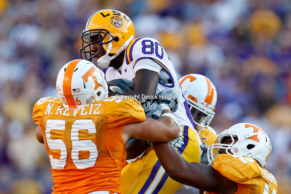 Oct 2, 2010; Baton Rouge, LA, USA; Tennessee Volunteers defenders tackle LSU Tigers wide receiver Terrence Toliver (80) during the second half at Tiger Stadium. LSU defeated Tennessee 16-14.  Mandatory Credit: Derick E. Hingle