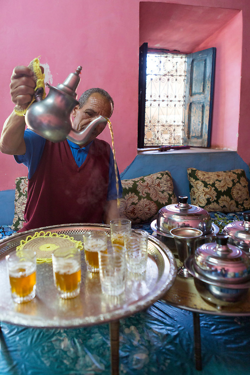 Berber man pours mint tea at his home in the High Atlas Mountains, Morocco