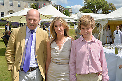 PEREGRINE & CAROLINE ARMSTRONG-JONES and their son ROBERT ARMSTRONG-JONES at the Cartier hosted Style et Lux at The Goodwood Festival of Speed at Goodwood House, West Sussex on 29th June 2014.