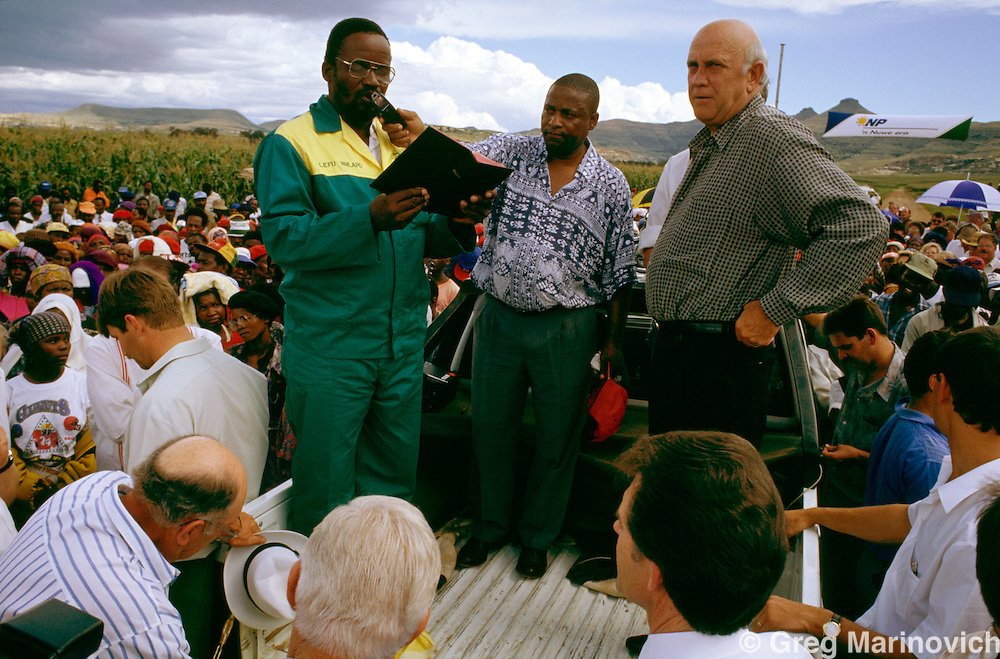 South Africans in a rural area gather to cheer President and National party leader FW de Klerk in the campaign for the first non-racial democratic elections in South Africa. 1994