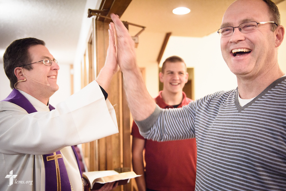 The Rev. Mark Nierman, pastor of Mount Olive Lutheran Church, high-fives Mike Allison before the second evening Lenten worship service on Wednesday, March 2, 2016, in Loveland, Colo. LCMS Communications/Erik M. Lunsford