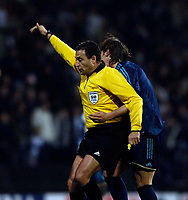 Photo: Jed Wee.<br /> Bolton Wanderers v Marseille. UEFA Cup. 15/02/2006.<br /> <br /> Ballroom dancing seems to make an appearance on the football pitch as referee O Benquerenca (L) accidentally backs into a Marseille player.