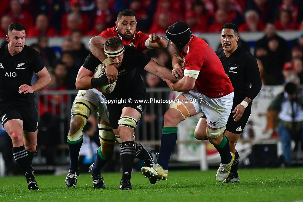 All Blacks' captain Kieran Read (C is tackled by Lion's Taulupe Faletau (Back) and Sean O'Brien (R during the All Blacks vs British and Irish Lions at Eden Park in Auckland on Saturday the 24th of June 2017. Copyright Photo by Marty Melville / www.Photosport.nz