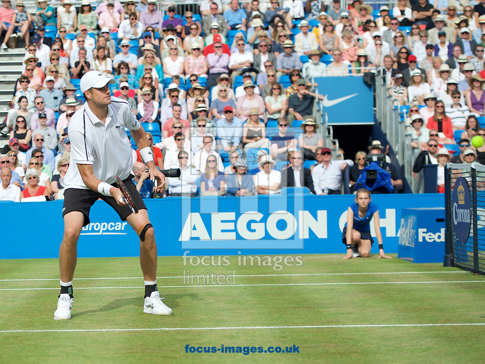 John Isner of the United States comes into the net during his second round match against Feliciano Lopez of Spain in the Aegon Championships at the Queen's Club, West Kensington<br /> Picture by Alan Stanford/Focus Images Ltd +44 7915 056117<br /> 18/06/2015