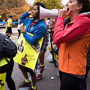 November 1, 2015 - New York, NY : Spectators including Sujan Doshi, center left, and Renee Hites (accent on first e), cheer on runners as they skirt Marcus Garvey Park in Harlem during the 2015 TCS New York City marathon on Sunday. <br />  CREDIT: Karsten Moran for The New York TImes