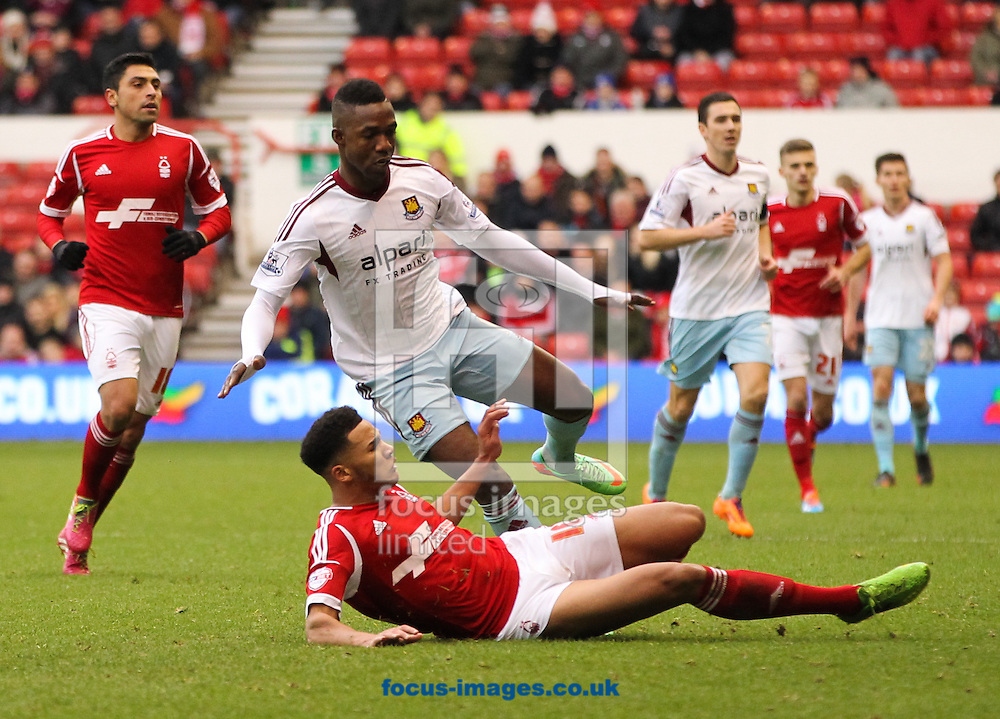 Picture by Tom Smith/Focus Images Ltd 07545141164<br /> 05/01/2014<br /> Jamaal Lascelles (centre bottom) of Nottingham Forest tackles Modibo Ma&iuml;ga (centre top) of West Ham United during the The FA Cup match at the City Ground, Nottingham.