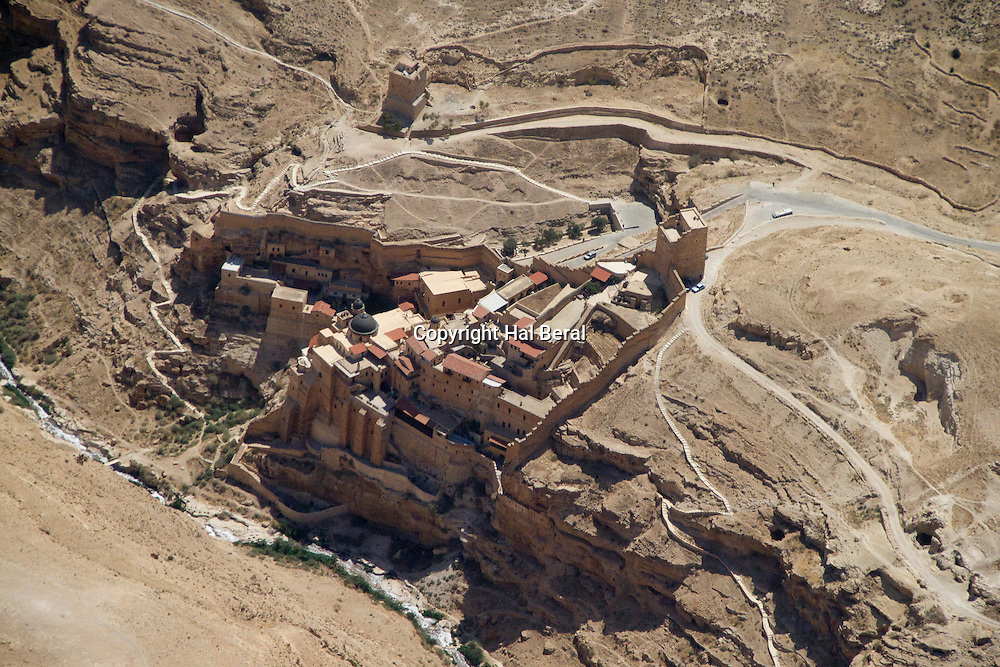 Aerial view of Mar Saba Monastery im the Judaean desert founded n 482 by St. Saba and fortified in the 8th and 9th centuries<br /> Judaean Desert,Israel