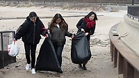 "The Jackson Park Advisory Council celebrated Earth Day Saturday afternoon, April 21st, 2018 with a clean up of 57th Street Beach. Volunteers from all over the city came to help.<br /> <br /> 7401 – University of Chicago students, Tina Jhang, Sunny Liu and Rachel Shang haul garbage that they collected from off of the beach.<br /> <br /> Please 'Like' ""Spencer Bibbs Photography"" on Facebook.<br /> <br /> Please leave a review for Spencer Bibbs Photography on Yelp.<br /> <br /> Please check me out on Twitter under Spencer Bibbs Photography.<br /> <br /> All rights to this photo are owned by Spencer Bibbs of Spencer Bibbs Photography and may only be used in any way shape or form, whole or in part with written permission by the owner of the photo, Spencer Bibbs.<br /> <br /> For all of your photography needs, please contact Spencer Bibbs at 773-895-4744. I can also be reached in the following ways:<br /> <br /> Website – www.spbdigitalconcepts.photoshelter.com<br /> <br /> Text - Text ""Spencer Bibbs"" to 72727<br /> <br /> Email – spencerbibbsphotography@yahoo.com"