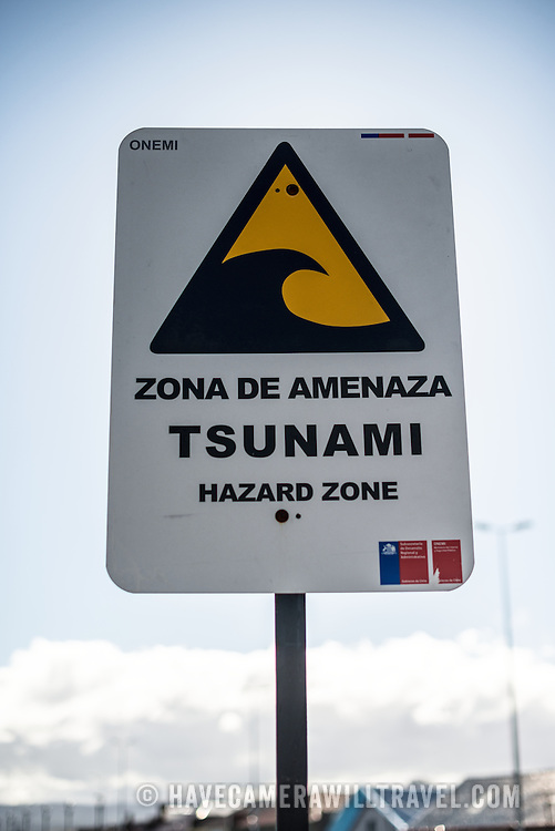 A tsunami wawrning sign in Punta Arenas, Chile. The city is the largest south of the 46th parallel south and capital city of Chile's southernmost region of Magallanes and Antartica Chilena.