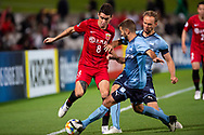SYDNEY, AUSTRALIA - APRIL 10: Shanghai SIPG FC player Oscar (8) and Sydney FC player Michael Zullo (7) fight for the ball at The AFC Champions League football game between Sydney FC and Shanghai SIPG FC on April 10, 2019, at Netstrata Jubilee Stadium in Sydney, Australia. (Photo by Speed Media/Icon Sportswire)