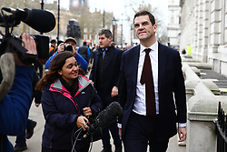 © Licensed to London News Pictures. 22/03/2019. London, UK. Chief Negotiater for Exiting the EU Olly Robbins leaves the Cabinet Office. The EU27 have agreed to Prime Minister Theresa May's request for a short extension to the deadline for leaving the European Union, offering two new deadlines depending on whether she is able to pass her deal next week. Photo credit: Rob Pinney/LNP