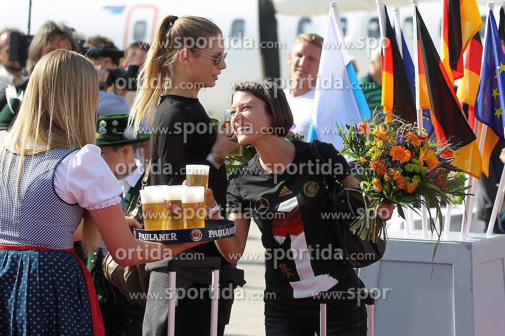 15.07.2014, Flughafen, Muenchen, GER, FIFA WM, Empfang der Weltmeister in Deutschland, Finale, im Bild l-r: Freundin Sarah Brandner von Bastian Schweinsteiger #7 (Deutschland) und Freundin Kathrin Gilch von Manuel Neuer #1 (Deutschland) // during Celebration of Team Germany for Champion of the FIFA Worldcup Brazil 2014 at the Flughafen in Muenchen, Germany on 2014/07/15. EXPA Pictures © 2014, PhotoCredit: EXPA/ Eibner-Pressefoto/ Kolbert  *****ATTENTION - OUT of GER*****
